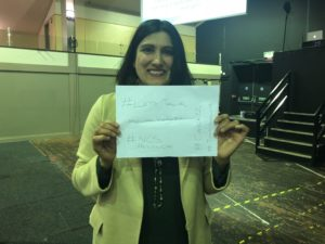 Image of a woman holding a sign with the hashtag #letstalkmentalhealth