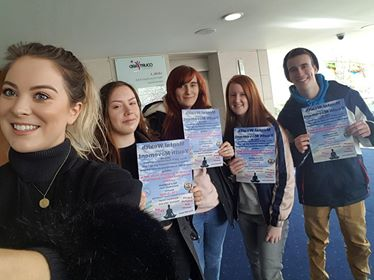 Photo of five NCS grads holding flyers about mental health