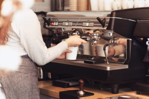 Barista, cafe, making coffee, preparation and service concept. Female hands at work